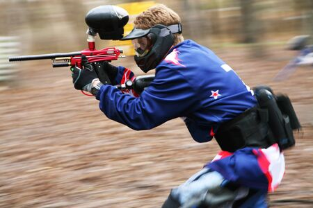 The running person with a gun for paintball