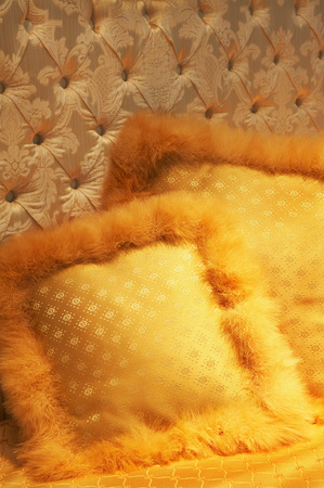 Two yellow silk pillows on a bed Stock Photo - 1512050
