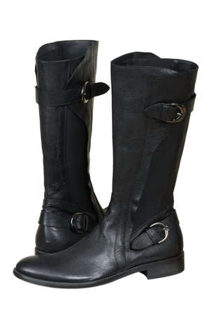 clasp feet: Black leather boots on a white background