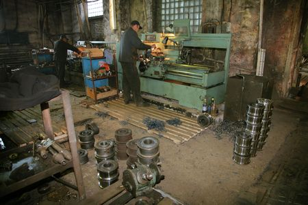 turner: Lathe and the turner at a machine-building factory Stock Photo
