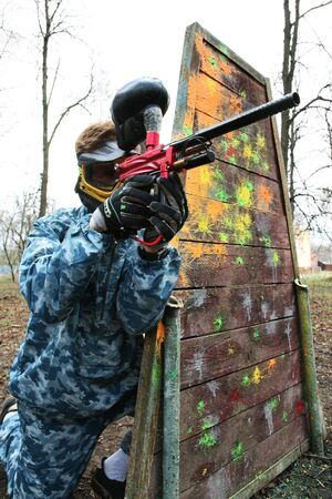 stimulated: Gun and mask for game in a paintball Stock Photo