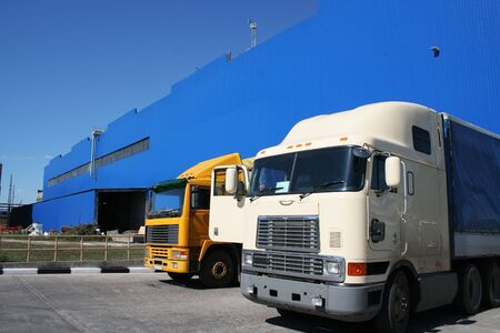 Two powerful lorries at a modern factory photo