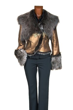 topcoat: Female winter jacket of gold color decorated by fur