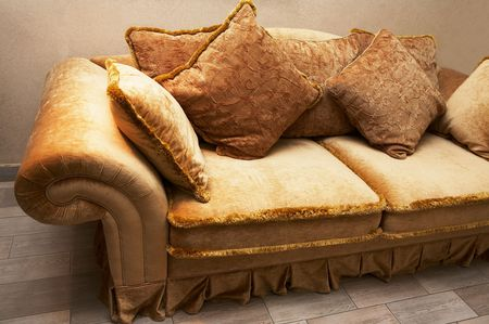 Beautiful and fashionable sofa with soft pillows photo