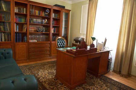 reading room: Bookcase, table and chair in a cabinet Stock Photo