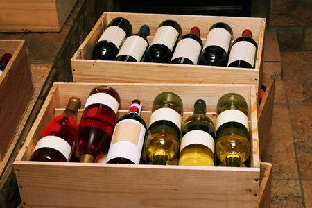 Red and white wine in bottles in wine shop photo