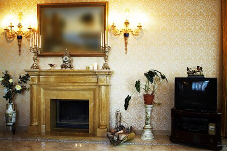 mantelpiece: Beautiful marble fireplace in a rich apartment