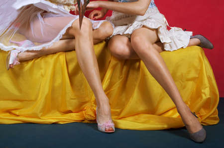 Two girls in shoes on a high heel photo