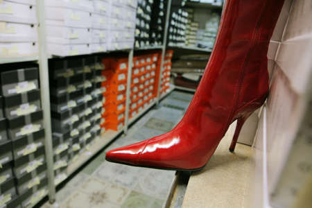 jackboot: Red female boot in a shoe warehouse