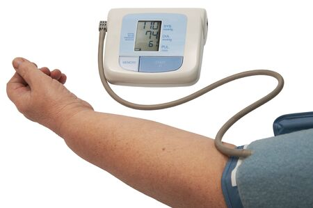 digital blood pressure monitor on a white background photo