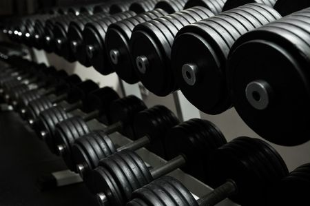 weight weightlifting: Heavy sports dumbbells in modern sports club
