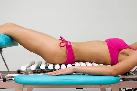 The girl in a pink bikini on a massage table photo