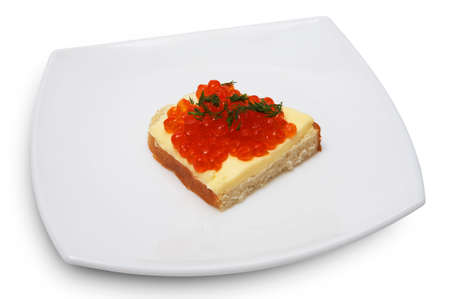 Sandwich with red caviar on a white plate photo