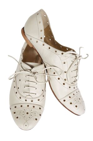 Fashionable low shoes on a white background photo