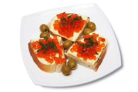 Sandwiches with red caviar on a white plate photo