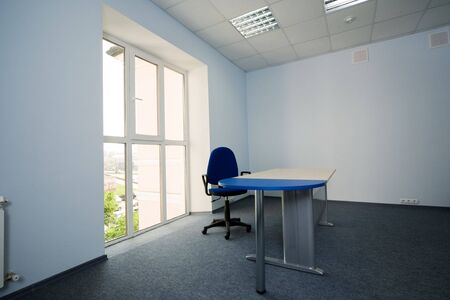 Chair and table at a window at modern office Stock Photo - 3088824