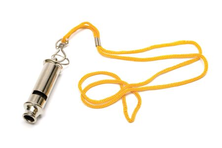 Metal whistle with a yellow cord on a white background photo