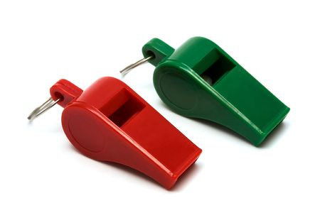 Red and green whistle on a white background photo
