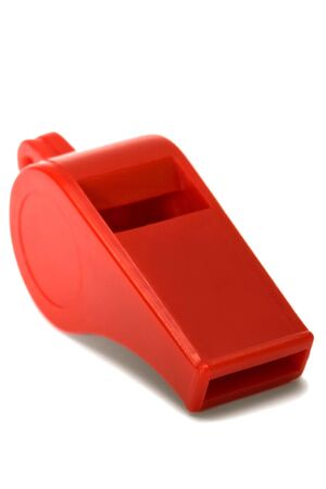 Red plastic whistle on a white background photo