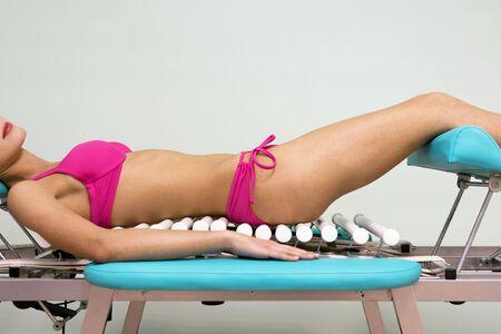 The girl in a pink bikini on a  table photo