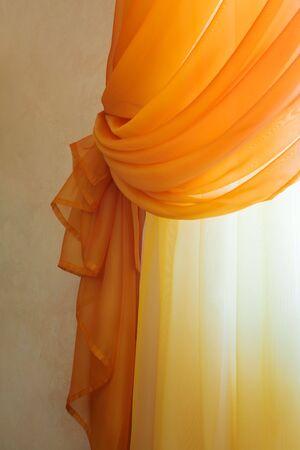 ornamentations: Beautiful translucent orange curtains in an apartment