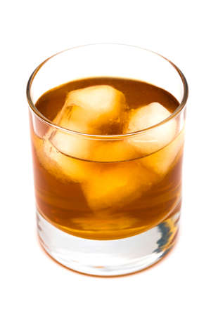 temperance: Glass of whisky with an ice on a white background Stock Photo
