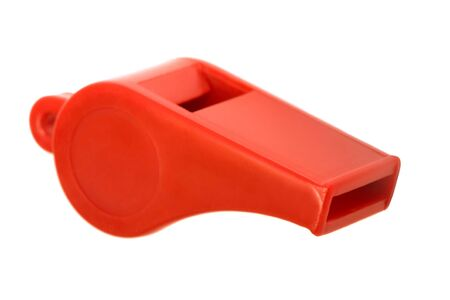 Red plastic whistle on a white background Stock Photo