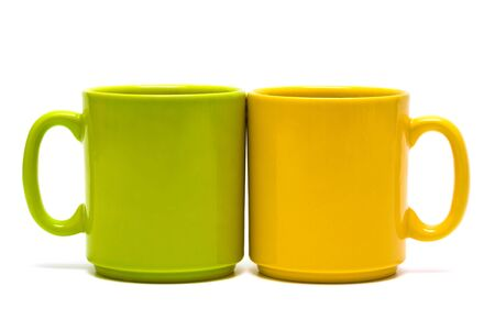 yellow and green mug on a white background Stock Photo - 3438158
