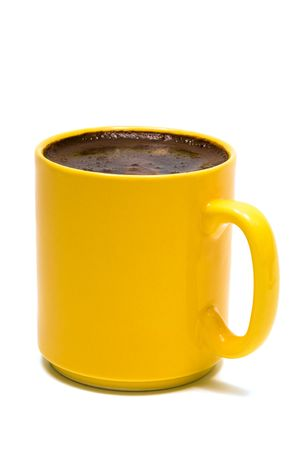 Yellow mug from coffee on a white background photo