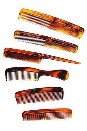Set of beautiful hairbrushes on a white background photo