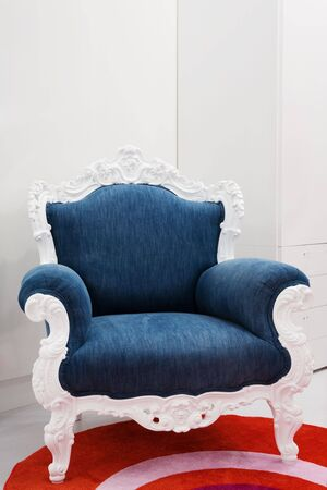 Armchair with a jeans fabric in a modern apartment photo