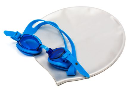 Glasses and cap for swimming on a white background photo