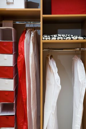 Clothes and towels in a wooden case photo