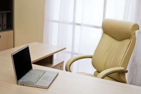 laptop on a table of director at modern office Stock Photo - 3906147