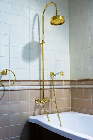 The beautiful bronze faucet and white bath photo