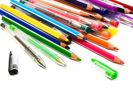 Color pencils and pens on a white background photo