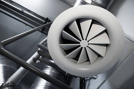 System of ventilating pipes at a modern factory photo