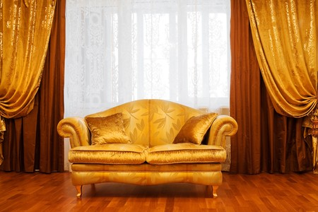 Beautiful sofa at a window in a modern apartment Stock Photo - 4202997