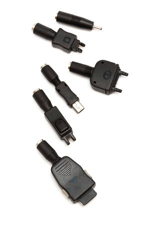 Adapters for a mobile phone on a white background