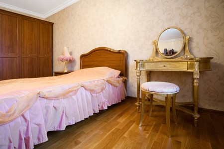 Bedroom with dressing table in modern apartment photo