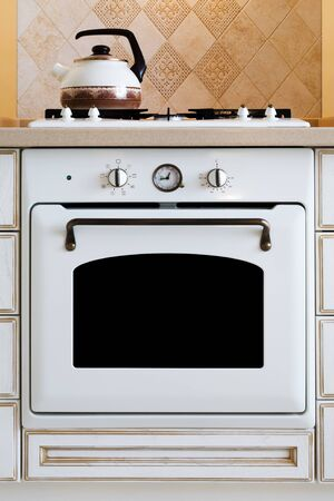 gas burners: kettle and gas cooker on modern kitchen