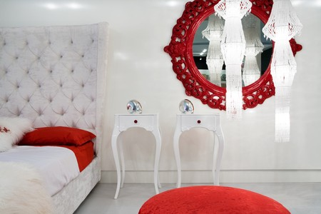 Bedroom with red mirror in modern apartment Stock Photo