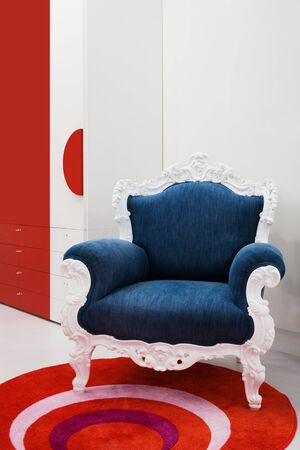 Armchair with a jeans fabric in a modern apartment