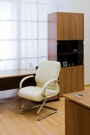Table, chairs and bookcase at modern office