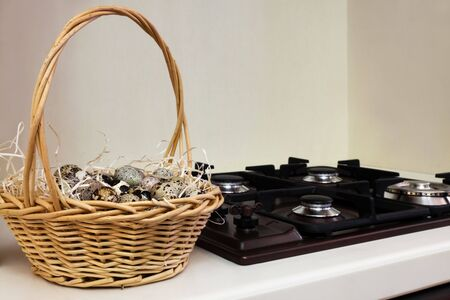 quail eggs in the basket at the gas stove photo
