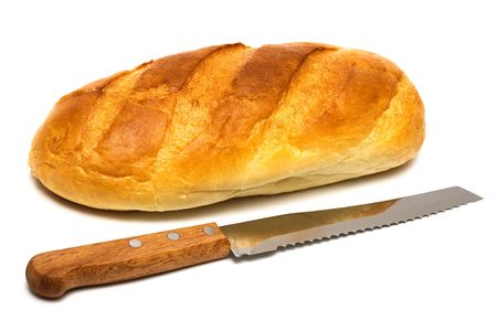 Fresh bread and knife on a white background photo