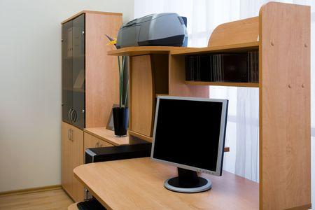 neat: Modern computer on a desk near the window Stock Photo