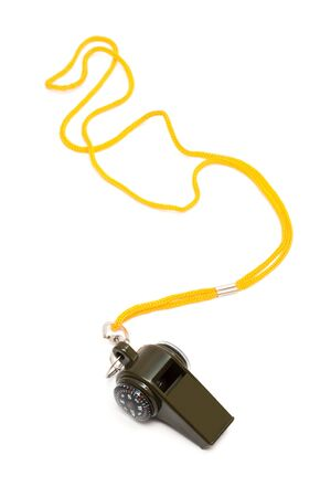 Whistle with a compass on a yellow cord photo
