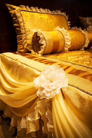 beautiful yellow pillows on the beds of modern photo