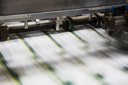 imprenta: Poligr�fico en un moderno proceso de imprenta